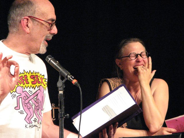 (Left) Balding man with glasses wearing Keith Haring shirt (Right) Laughing woman with glasses