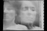 Blurred image of two faces