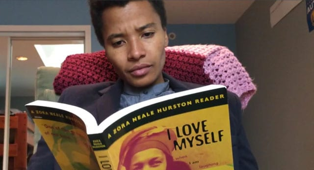 african american woman reading I love myself book